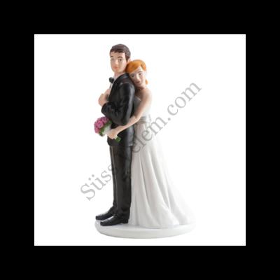 Ölelkezős nászpár esküvői tortadísz